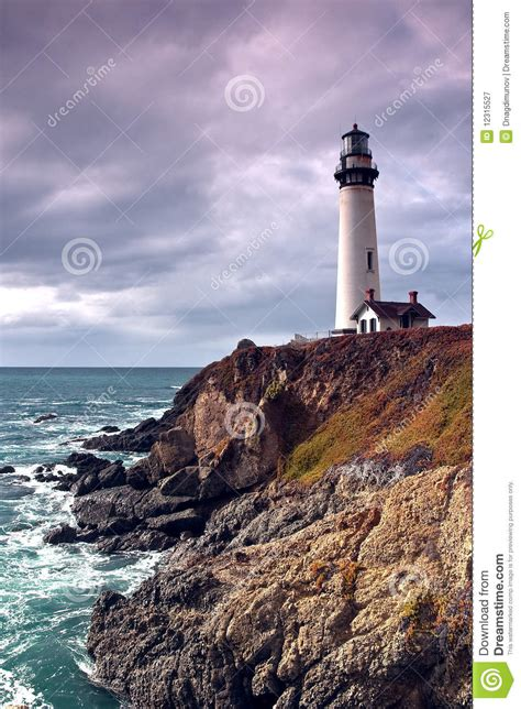 Lighthouse On A Cliff And Ocean Royalty Free Stock